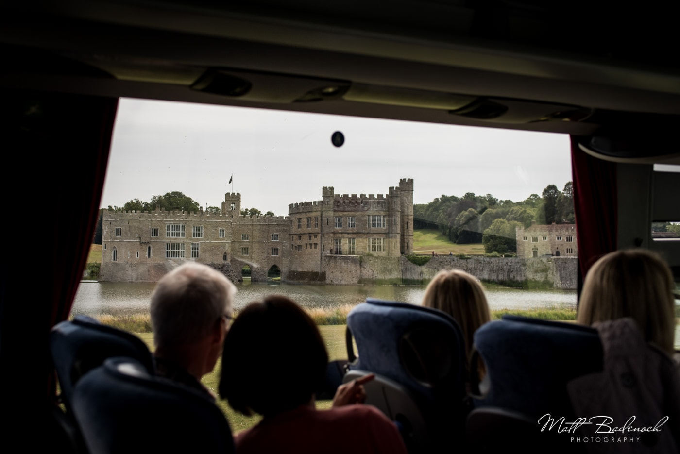 Guests looking at Leeds Castle through the coach window