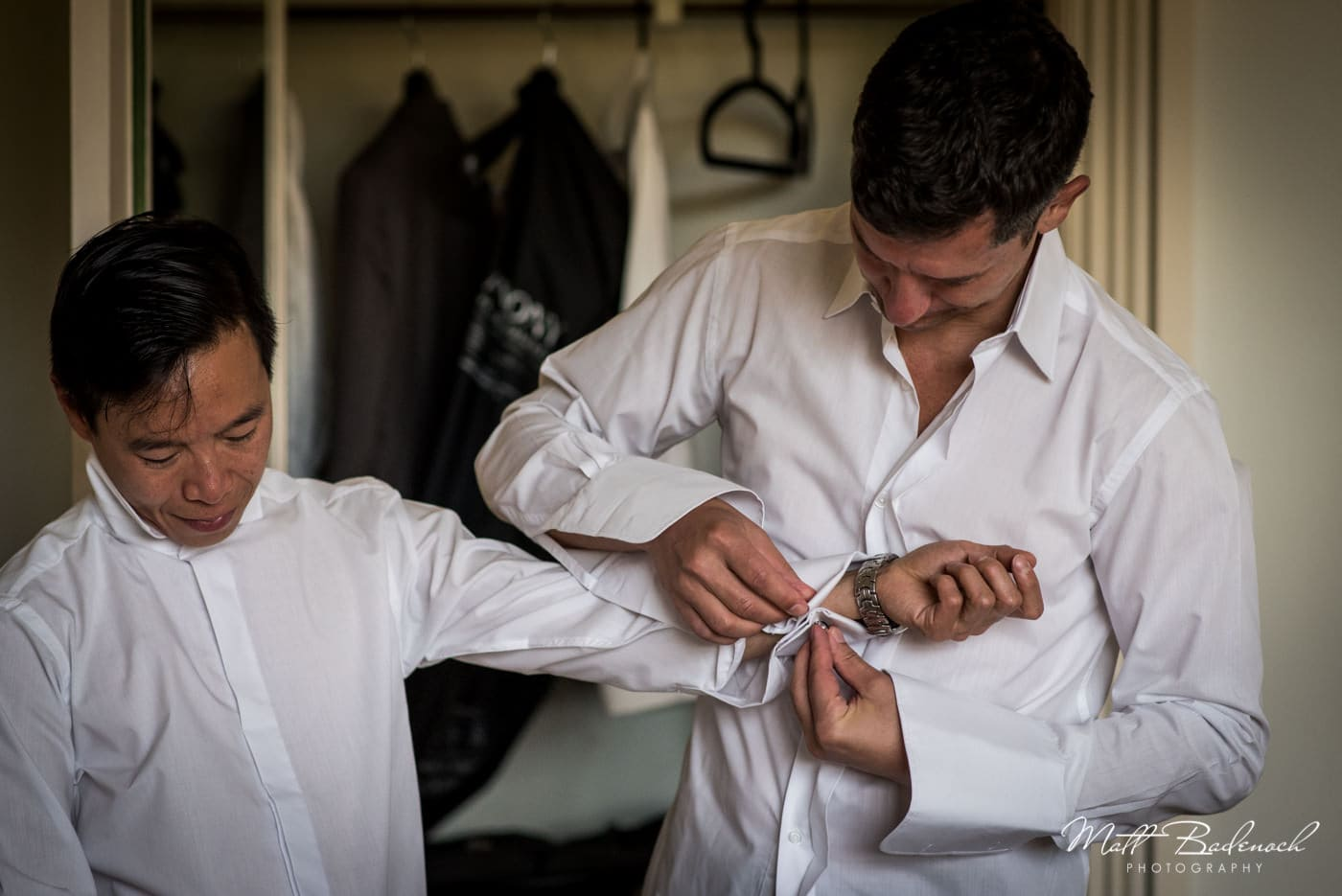 Grooms getting ready before their samesex wedding at Leeds Castle