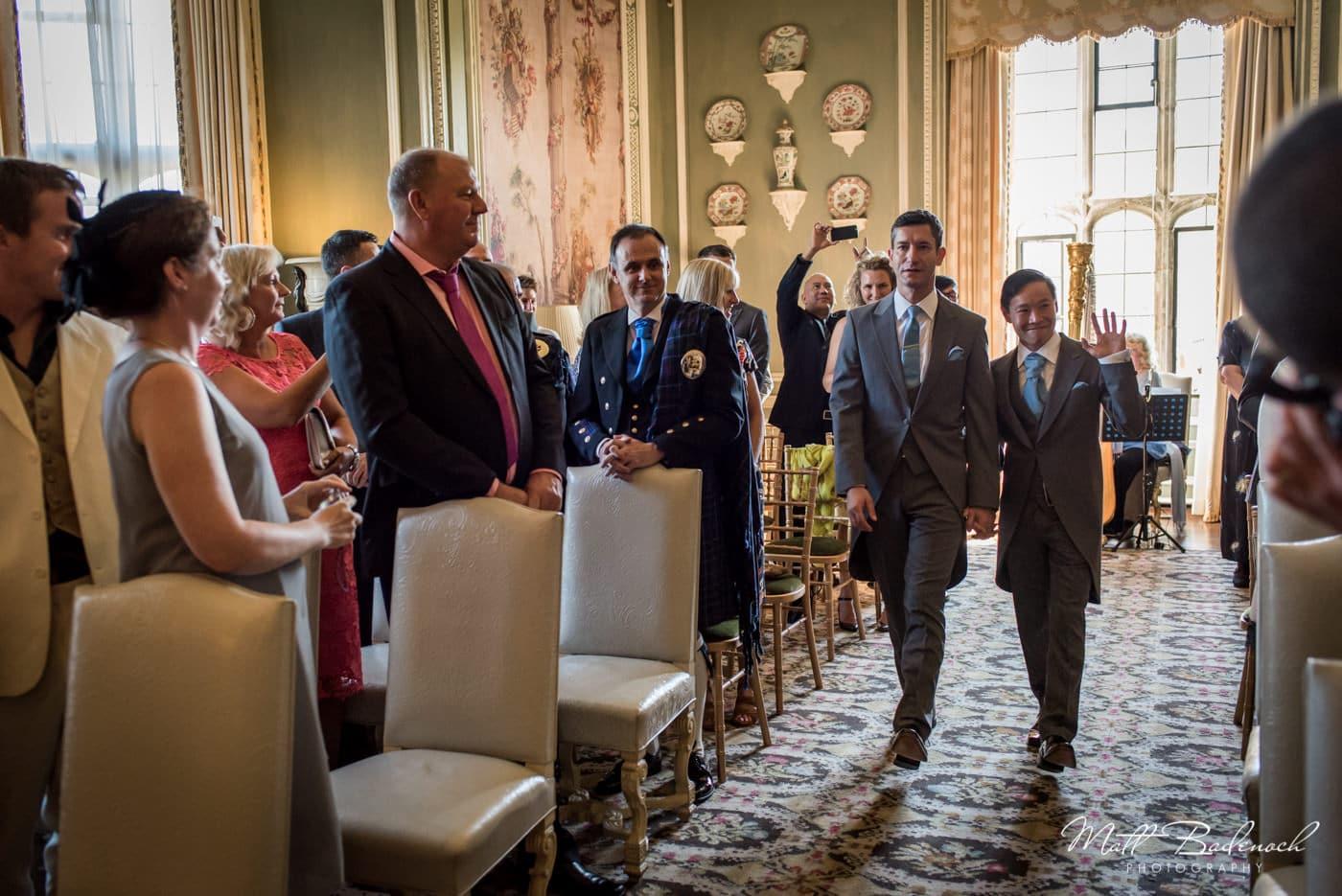 Groom's walking down the isle at their Leeds Castle wedding