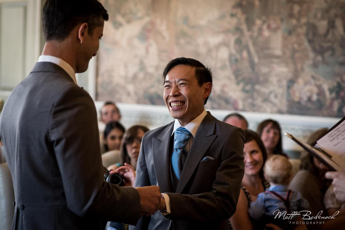 Groom smiling during ceremony at his Leeds Castle Wedding