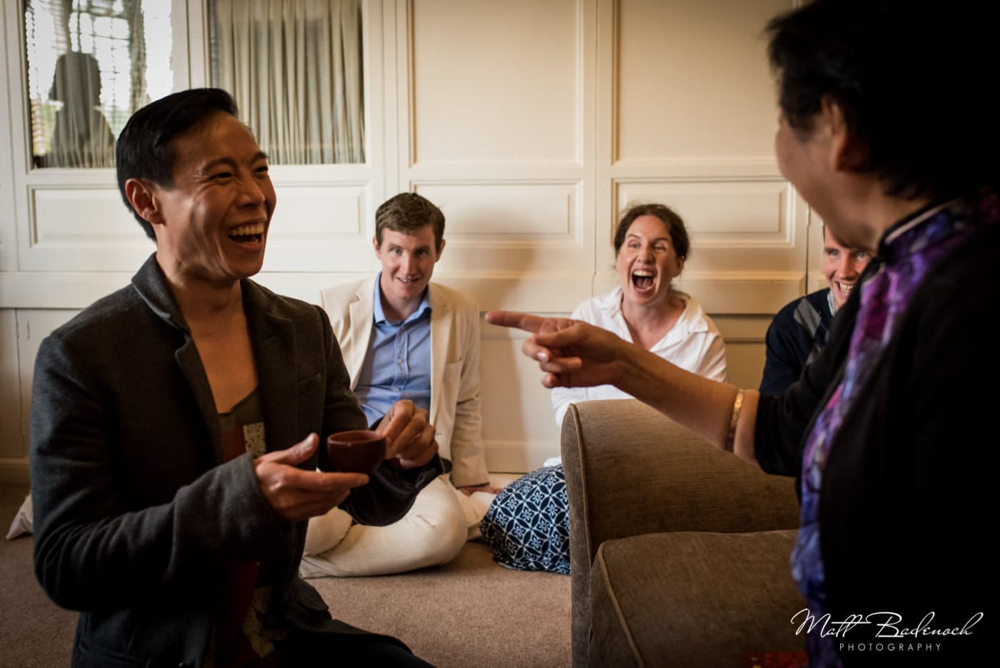Laughing at Chinese Tea Ceremony at Leeds Castle