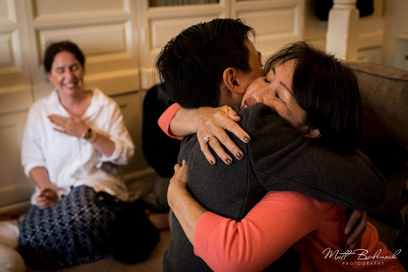 Hugging at a Chinese Tea Ceremony at a Leeds Castle Wedding