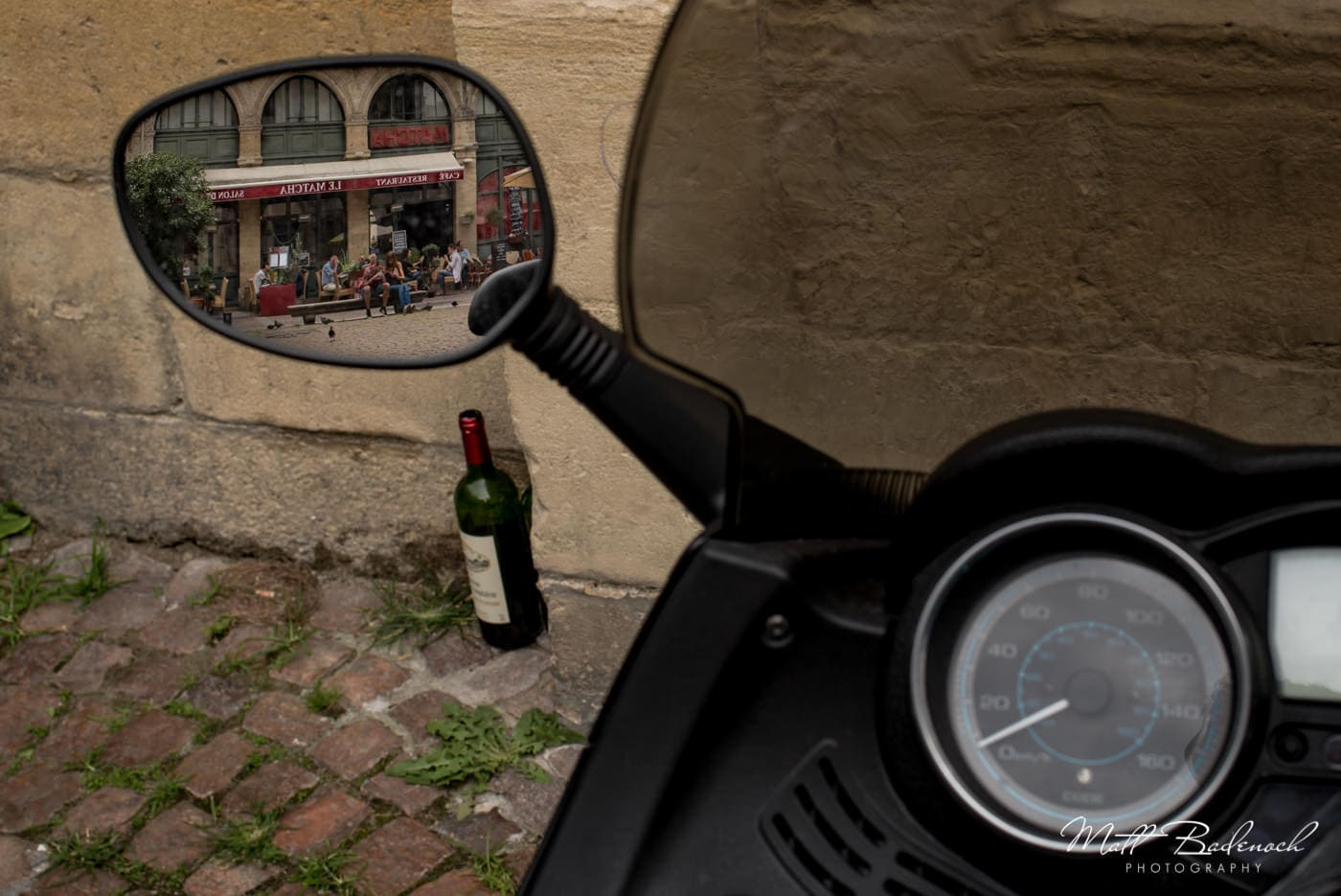 scooter, bottle of wine reflection of french cafe | bordeaux street photography