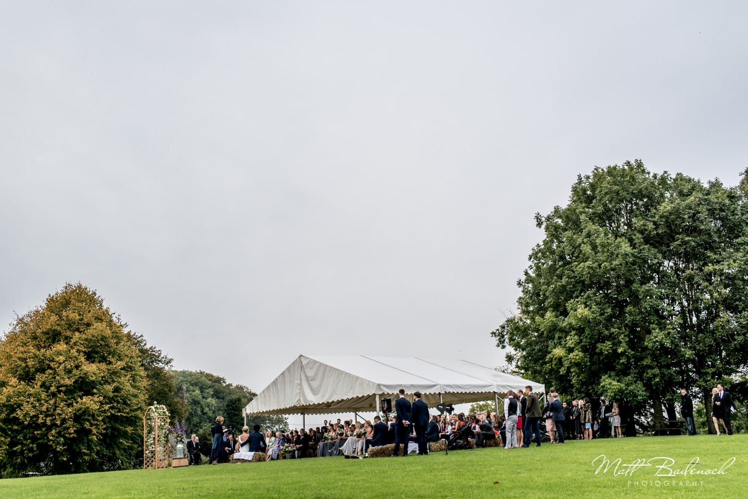 Outdoor wedding ceremony at Wookey Hole in Somerset
