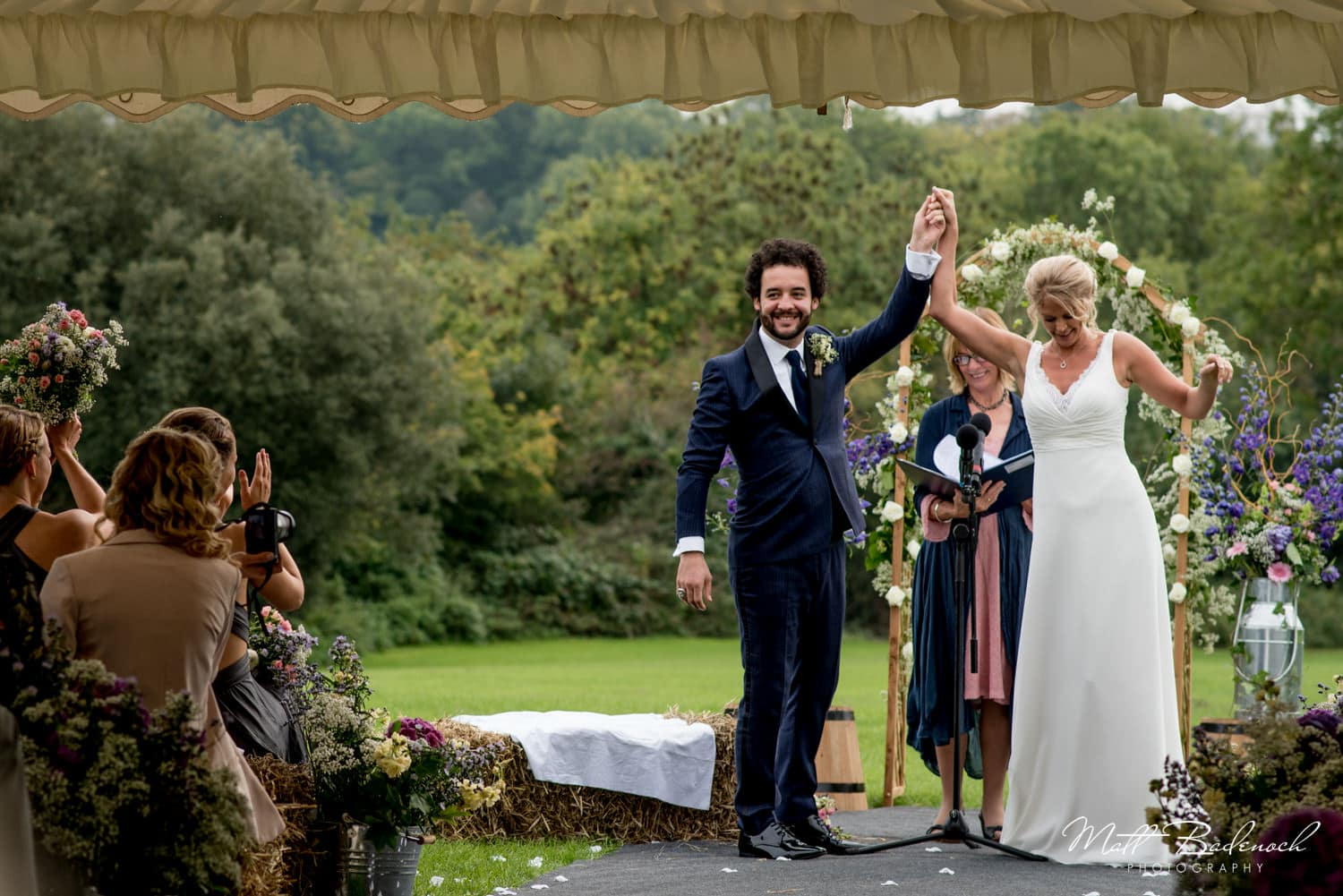 Bride and groom celebrating at their Wookey Hole Wedding Ceremony
