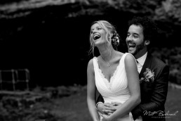 B&W photo of bride and groom laughing at their Wookey Hole Wedding
