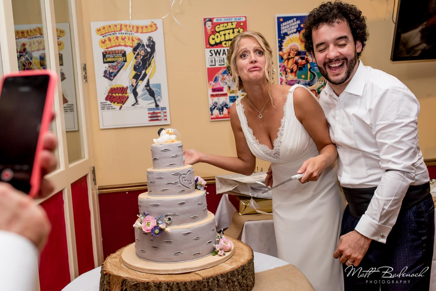 Bride and Groom cutting cake at their Wookey Hole Wedding.