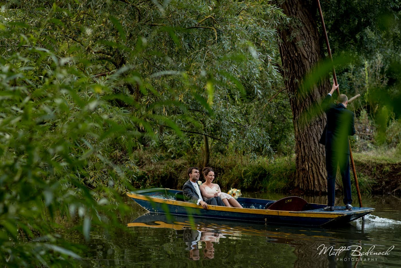 Punting at a wedding at Lady Maragret Hall | Oxford documentary wedding photography