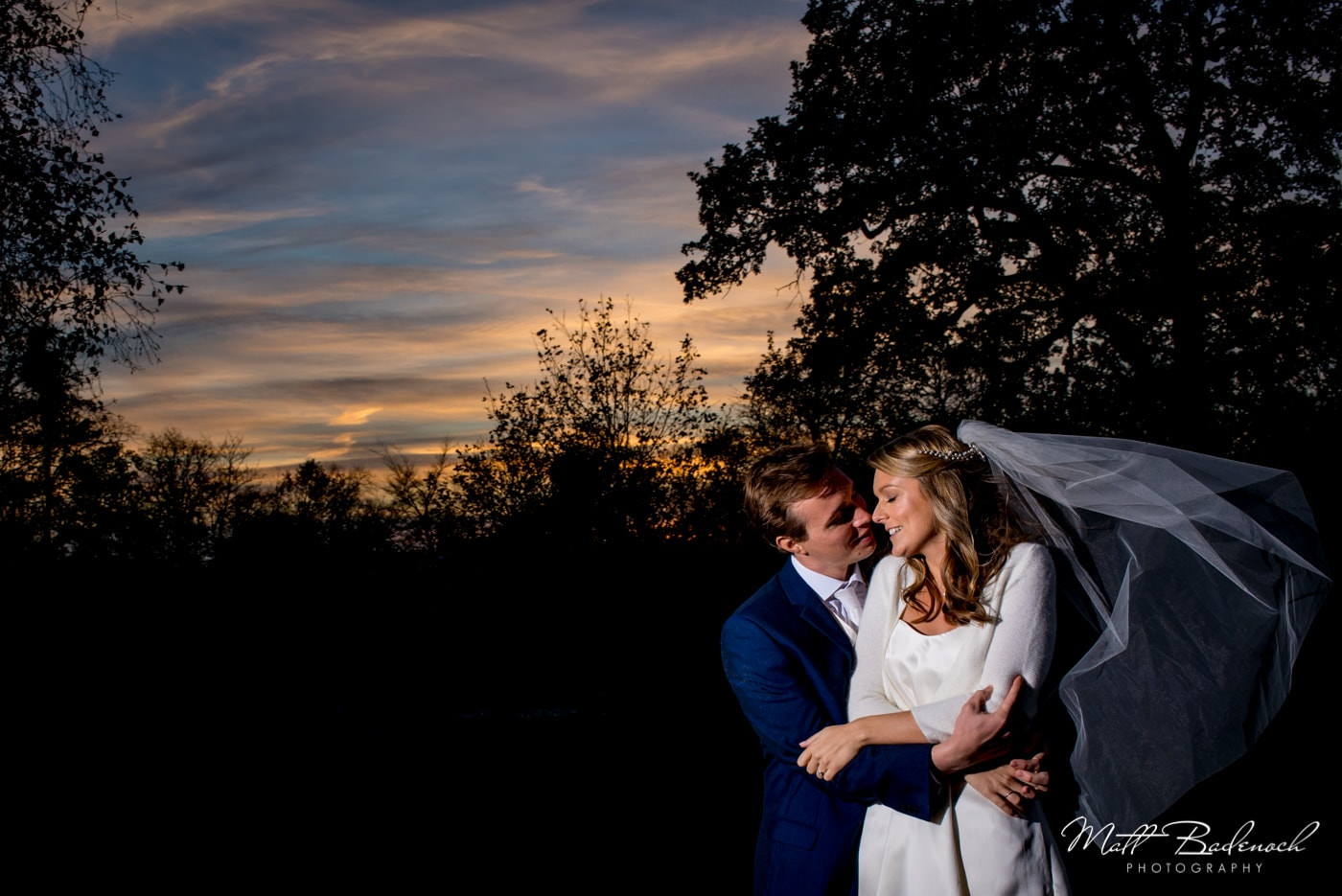Bride and groom winter portrait during sunset