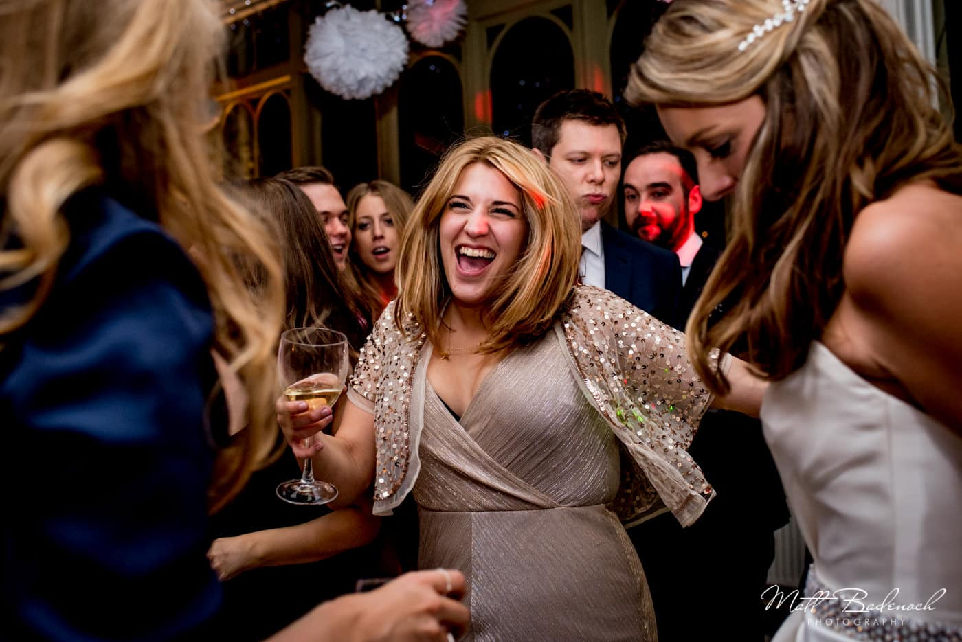 Girl partying and dancing at a Hampton Court House Wedding