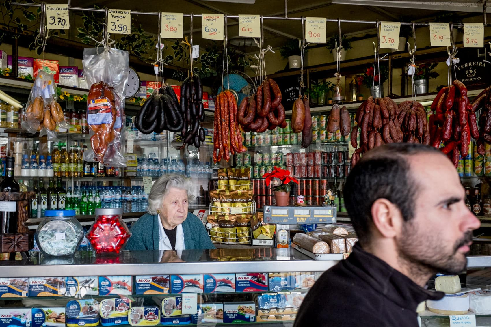 woman at her market stall in Mercado do Bolhao, Porto