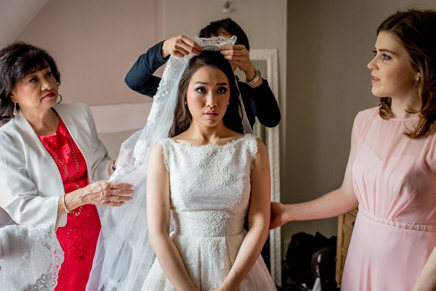 Chinese Bride getting ready with her parents at Houchins Barn