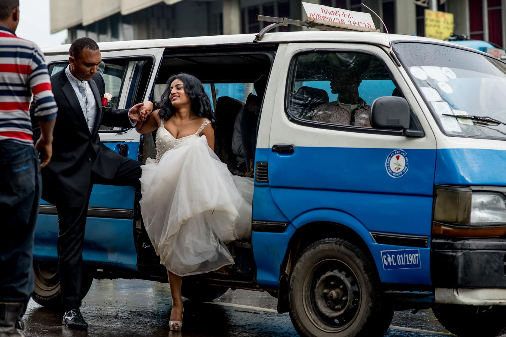bride and groom getting out of a mini bus in addis ababa