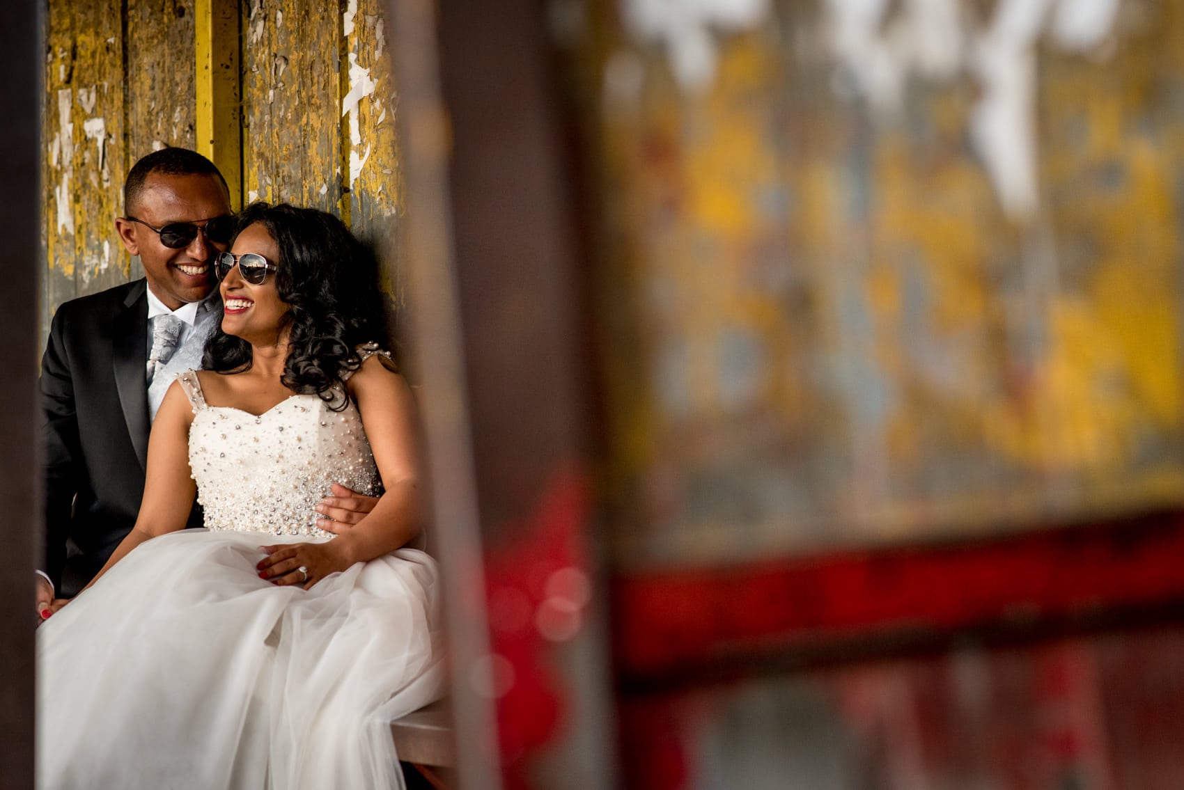 bride and groom portraits at a bus stop in Ethiopia