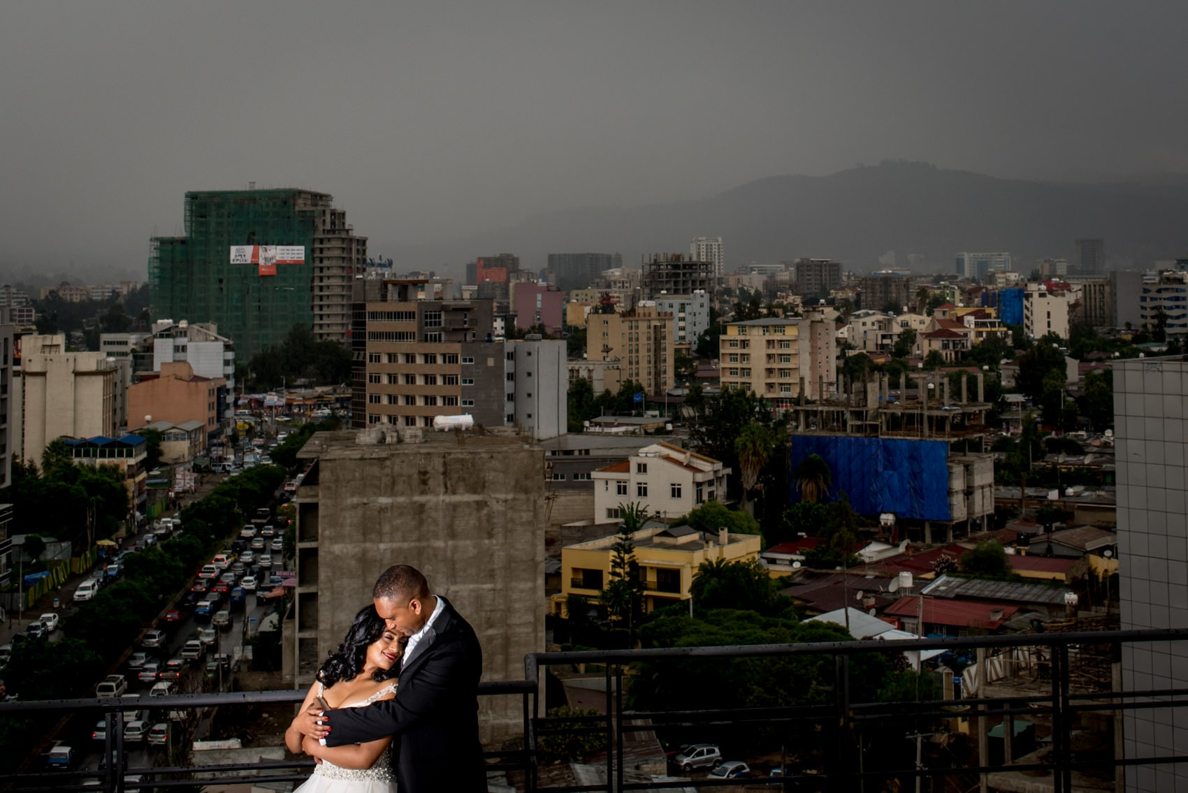 ababa wedding portraits in Ethiopia, Africa with a storm skyline