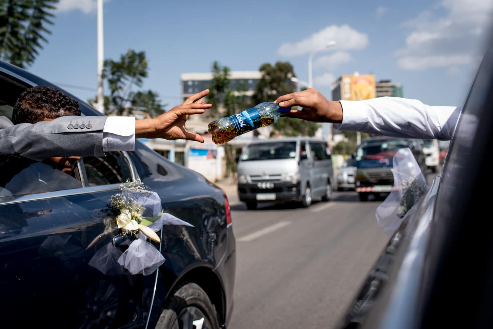 handing out whisky on the motorway in Addis Ababa