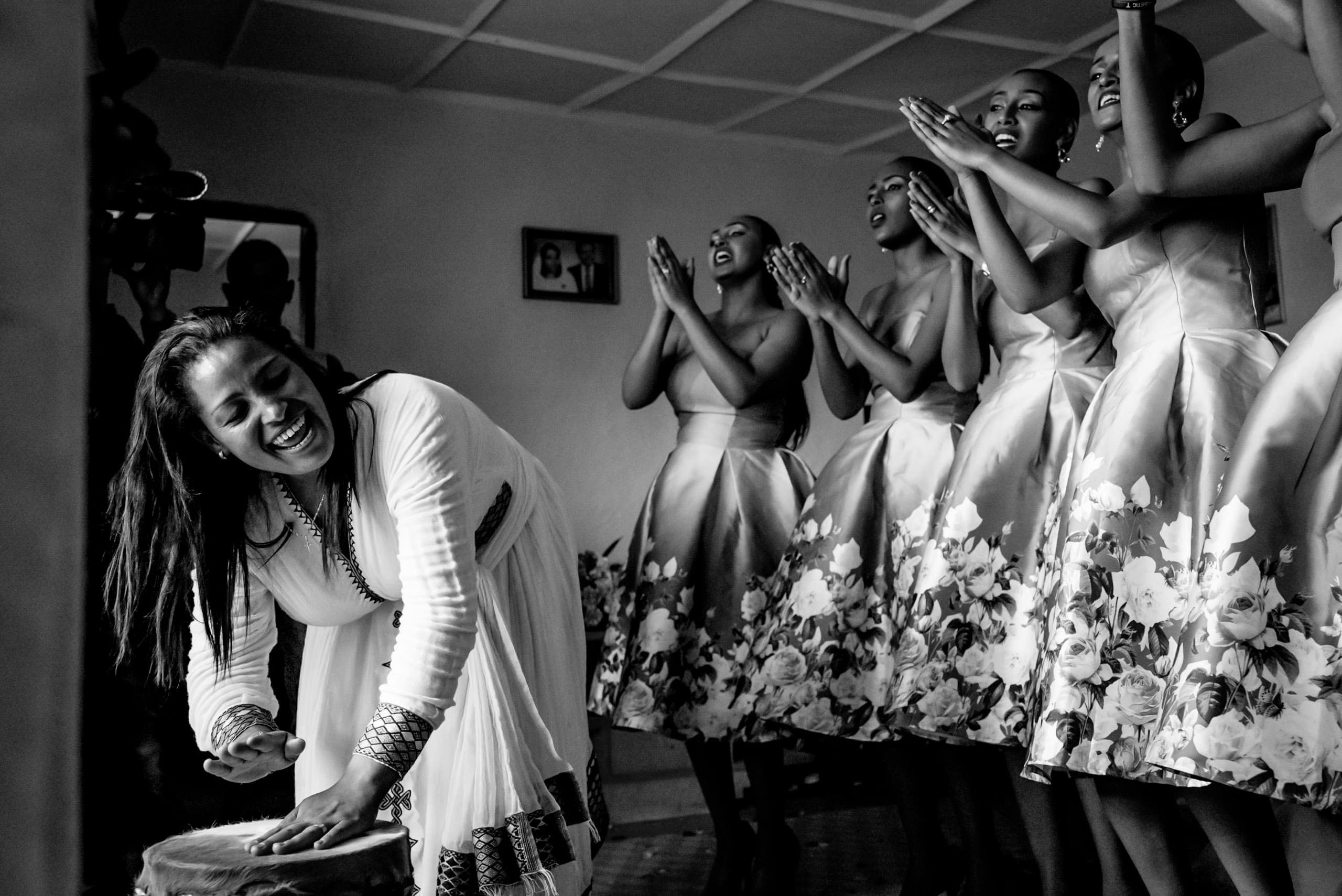 Bridesmaids drumming and an Ethiopian wedding photographer in Addis, East Africa.