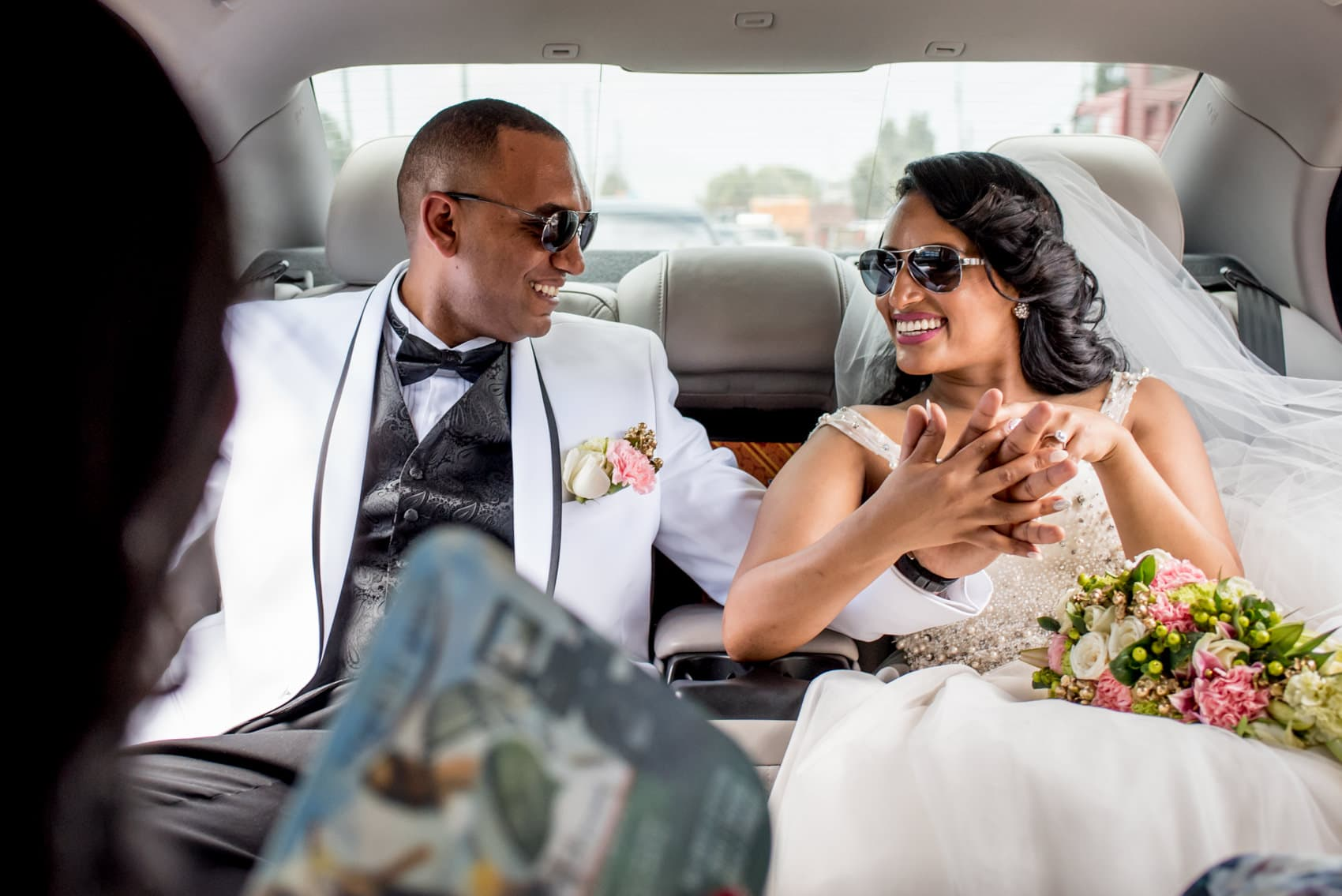 Ethiopian bride and groom in a limo