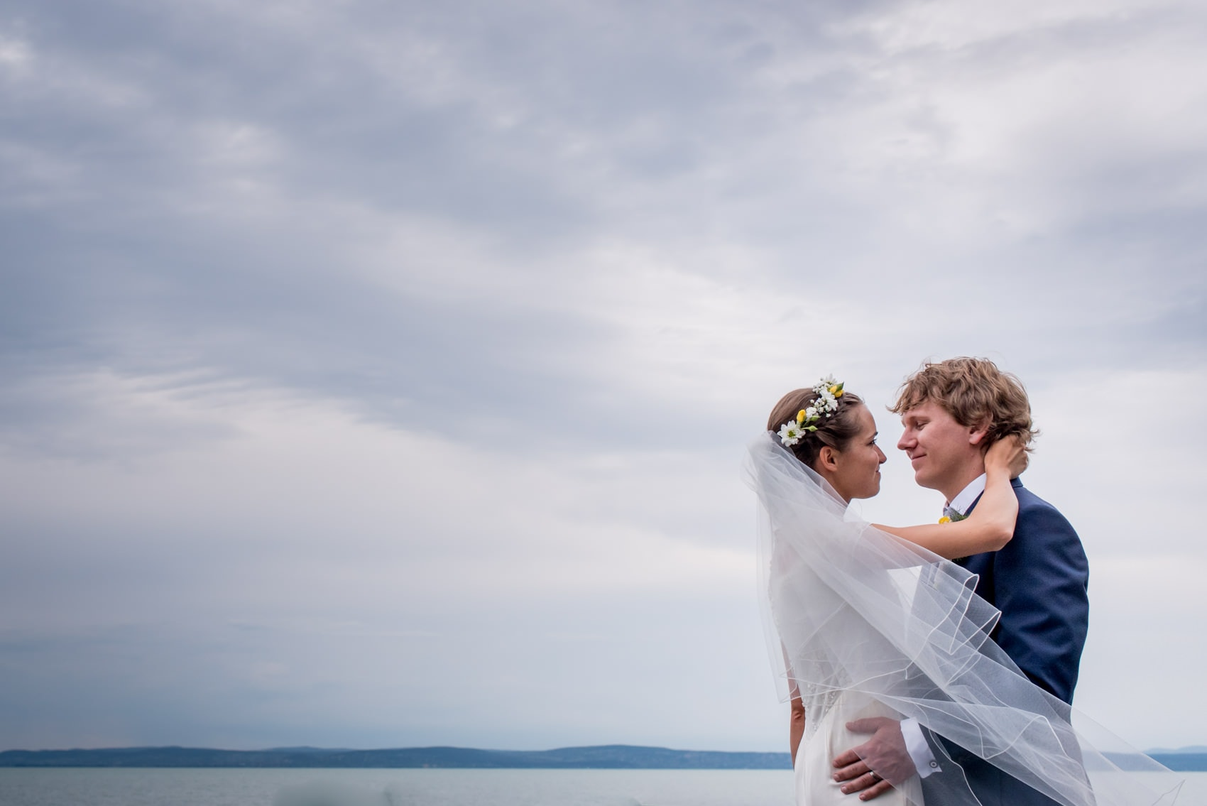 Hungarian bride and groom at their wedding on the shores of lake balaton