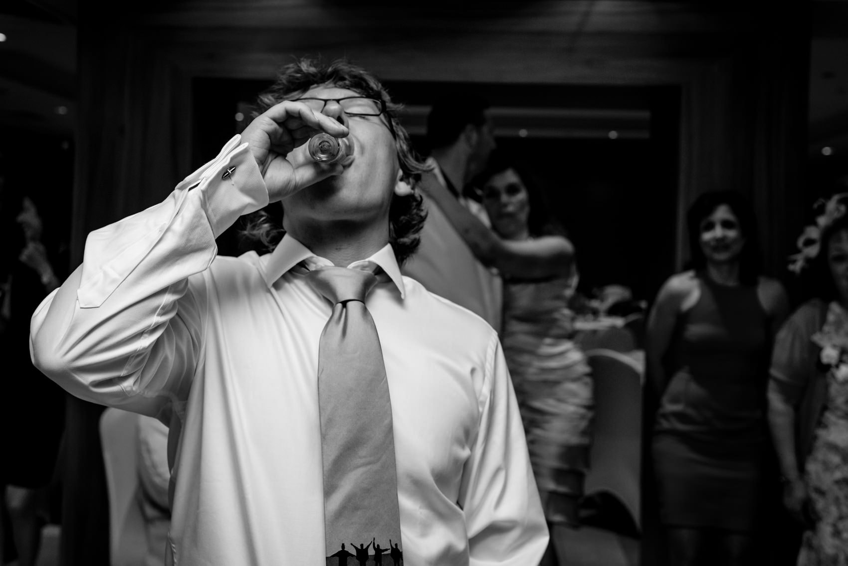 groom doing shots at his wedding