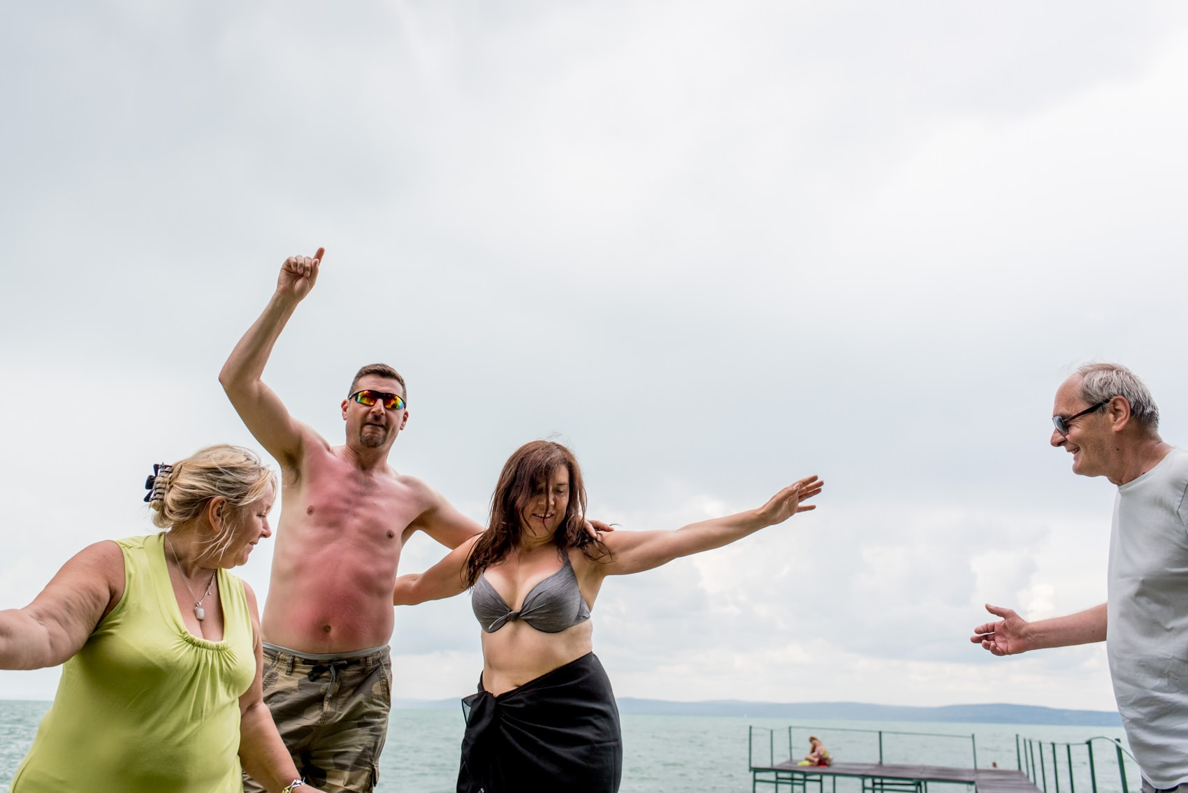 British wedding guests partying outside on shore of Lake Balaton