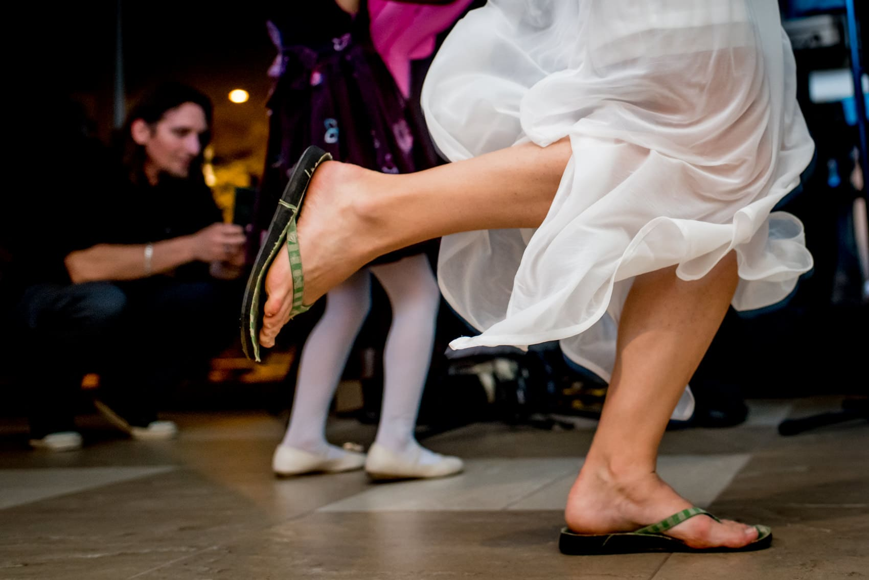bride wearing flipflops on the dancefloor