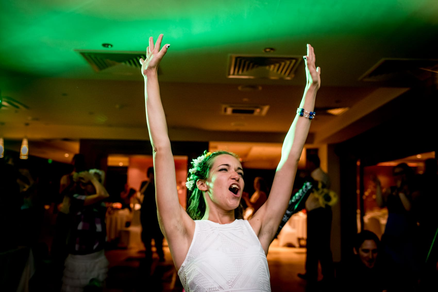photo of bride partying on the dance floor, taken by a Hungary wedding photographer