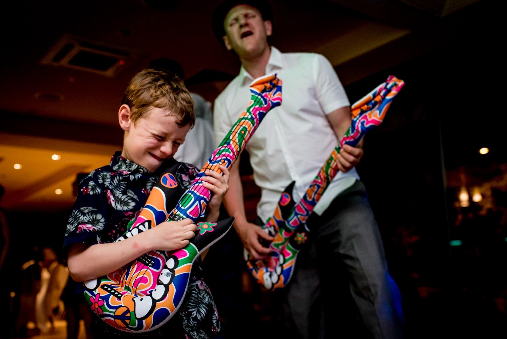 rock and roll wedding dancefloor with air guitars