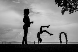hungary wedding photographer photographing kids playing on the show of Lake Balaton