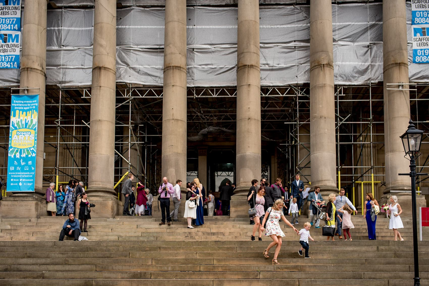 wedding guests outside Leeds Town Hall