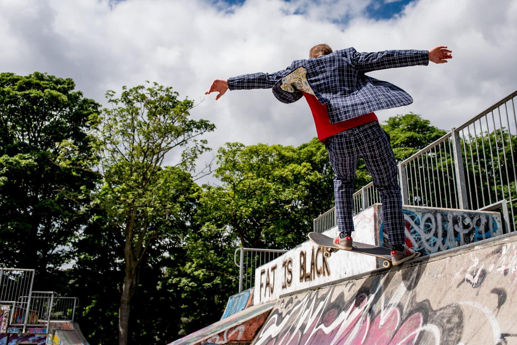 wedding guest skateboarding at Hyde Park skate park in Leeds