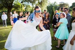 bride blind folded for her wedding garden games