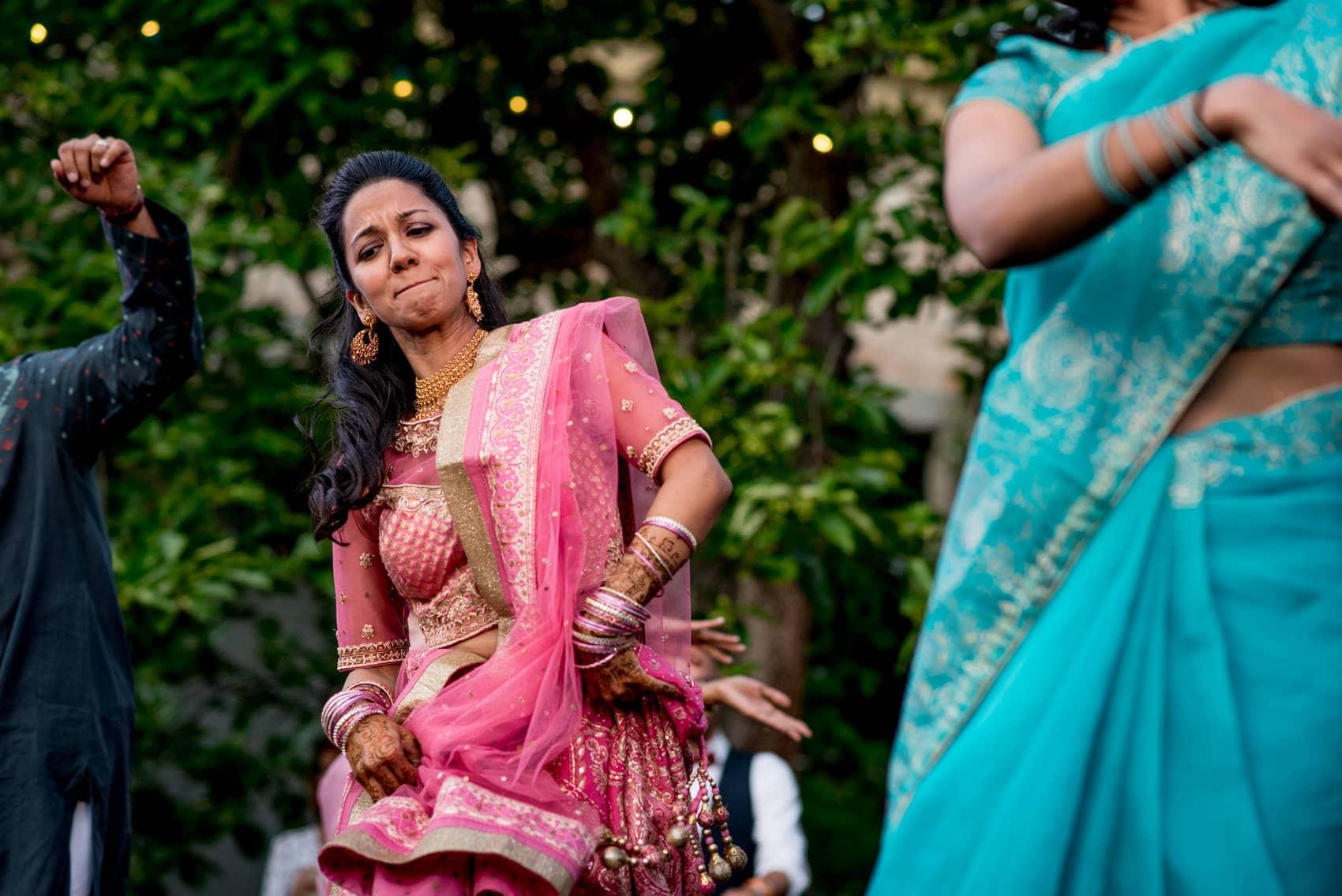 A florence wedding photographer capturing Indian dancing at Giardino Corsini al Prato