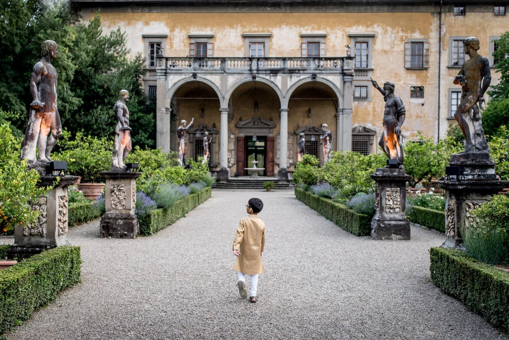 boy exploring a wedding at Giardino Corsini al Prato in Florence