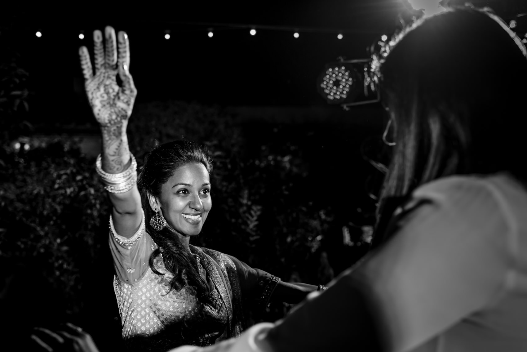 indian bride having fun on the dance floor in Florence