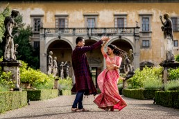 Indian bride and groom dancing photo taken by a Florence wedding photographer in Italy