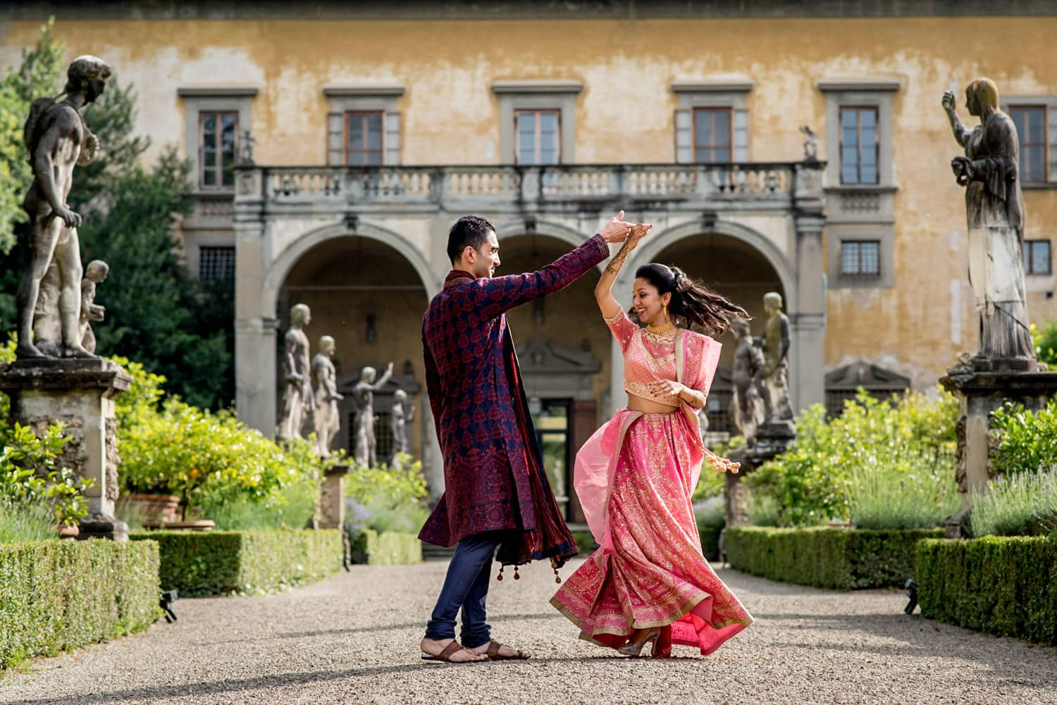 indian bride and groom dancing at their florence wedding in italy