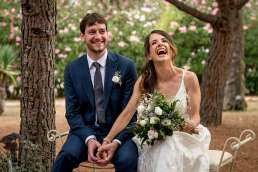 Photo of bride and groom laughing during ceremony captured by London wedding photographer Matt Badenoch