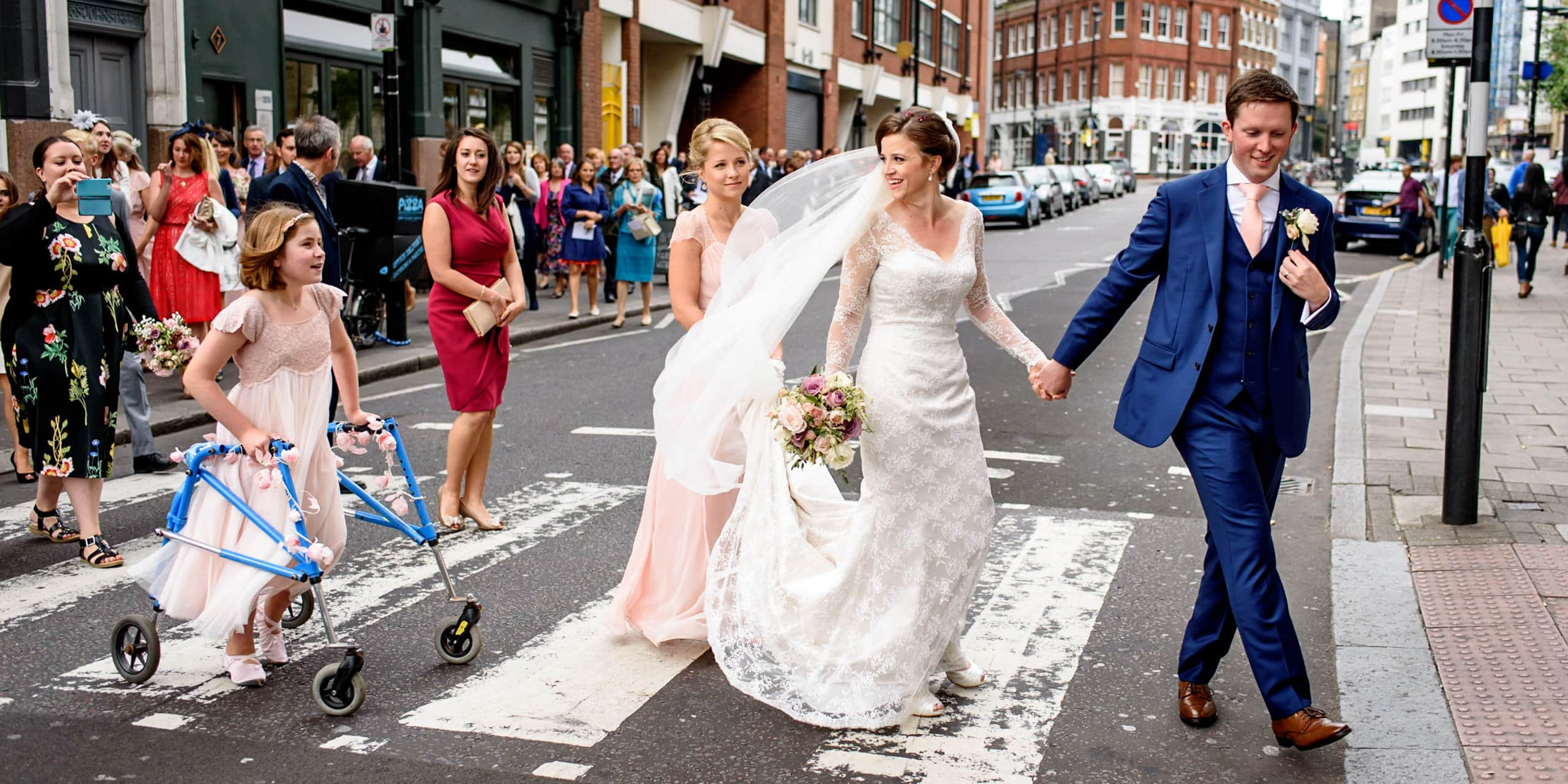 Bride and crossing London at her urban wedding at St Barts Brewery take my London wedding photographer Matt Badenoch