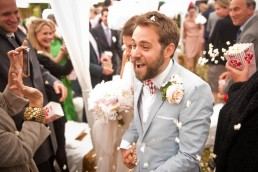 Popcorn confetti being thrown at groom