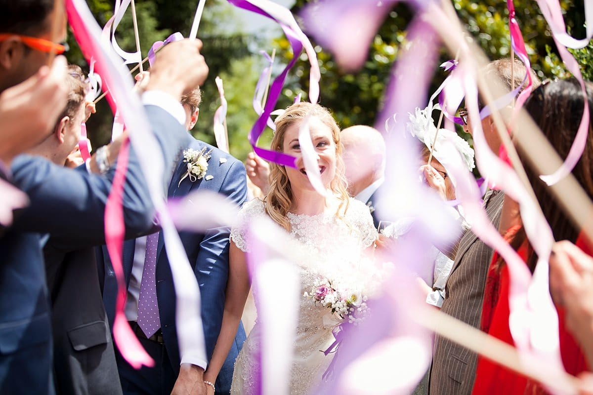 flying ribbons being used as wedding confetti