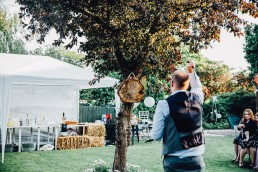 groom throwing axes in the garden at his wedding