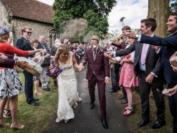 lavender confetti being thrown at wedding couple