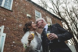 wedding couple with snow from snow machine confetti