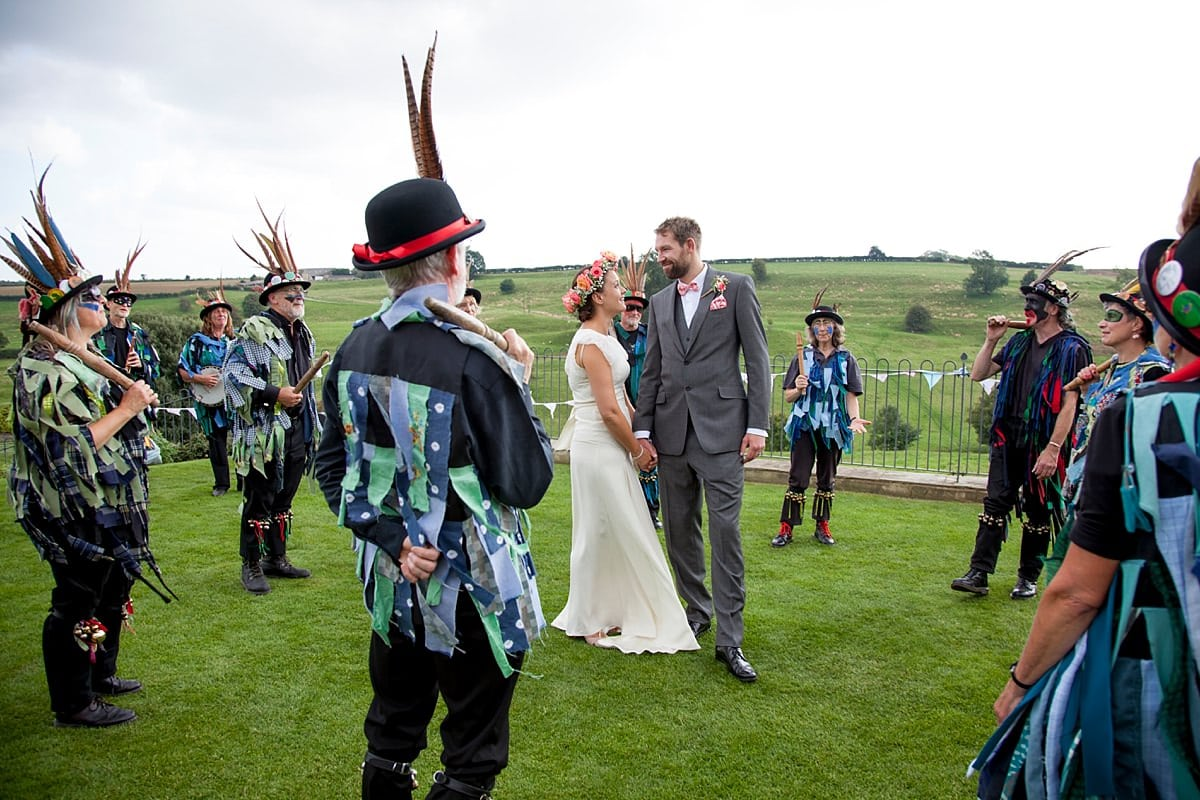 bride and groom with morris dancers
