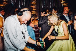 wedding guests partying with headphones to a silent disco