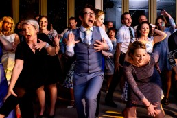wedding guests taking part in a swing dancing class