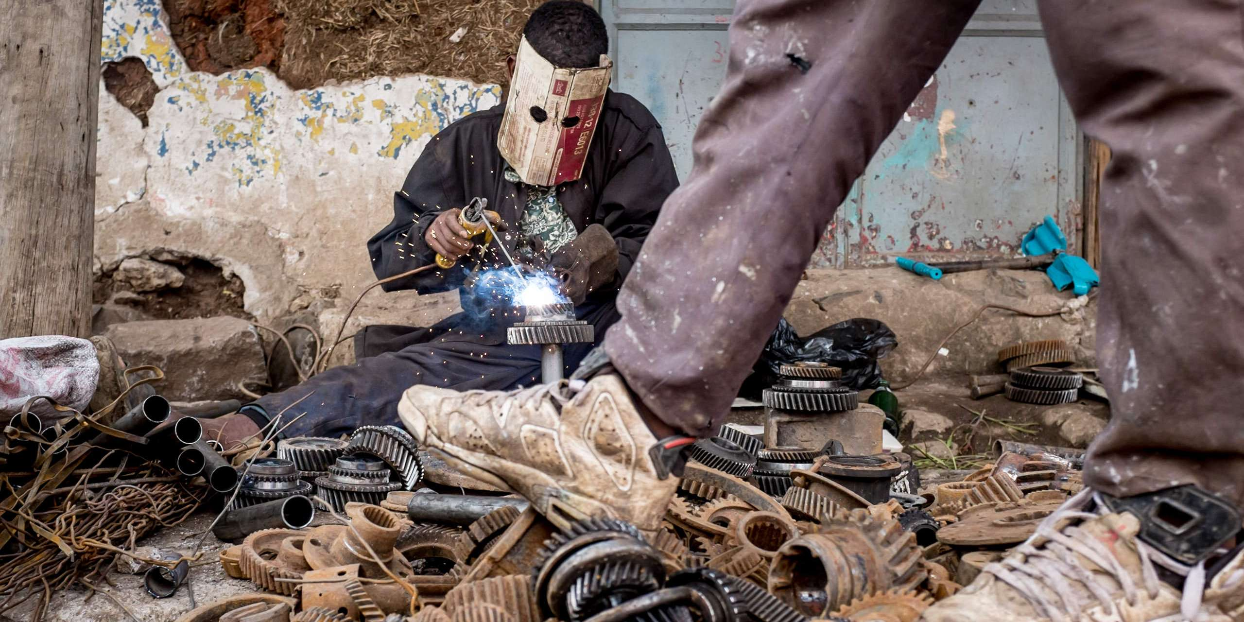 DIY welder in market place in Addis Ababa street photography in Ethiopia