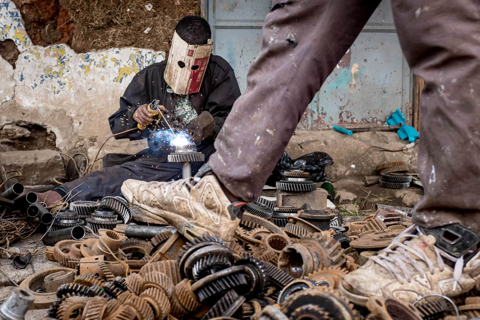 Man doing some DIY welding in Addis Merkato Ethiopia