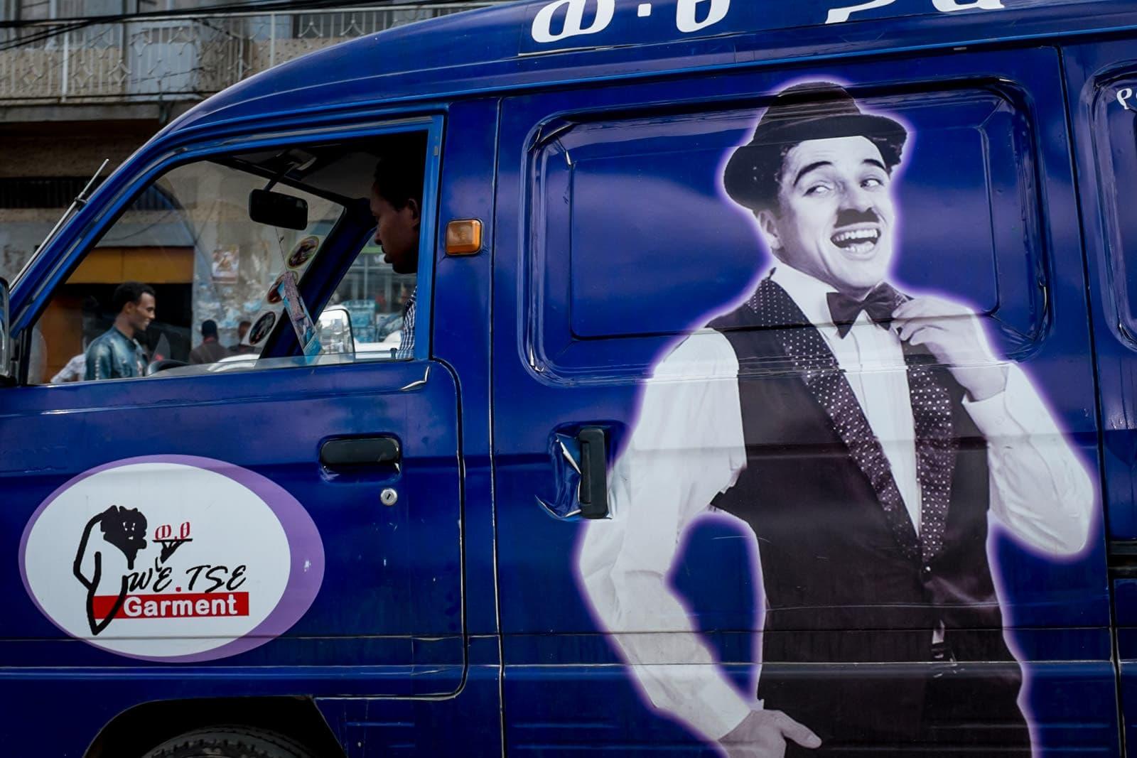 Charlie Chaplin on the side of a purple van in Addis Ababa, Ethiopia, Afriac